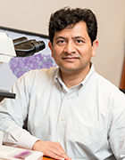 """Environmental portrait of Dr. Vivekananda """"Anand"""" Datta, Molecular Characterization Laboratory, Leidos Biomedical Laboratory, Inc.   Photographed for the ATRF Culture Club."""